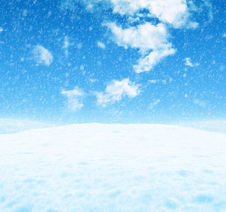 white clouds: White snowy landscape under a blue sky with light clouds Stock Photo