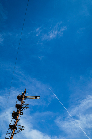 Mechanical semaphore entry signal and contrail 写真素材