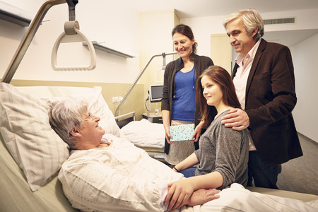 hospital bed: Hospital visit family with patient
