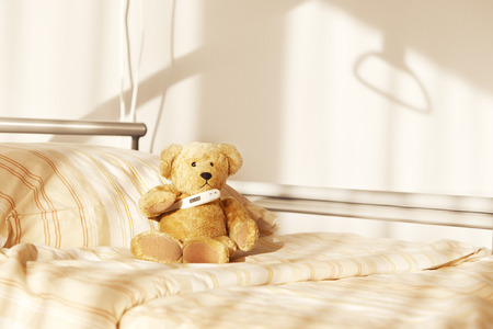 Room with bed and teddy bear in hospital Banco de Imagens