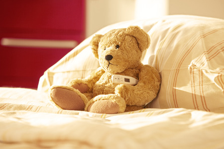 Room with bed and teddy bear in hospital Stockfoto