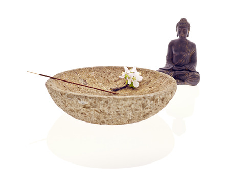 Buddha with bowl blossom and joss stick photo