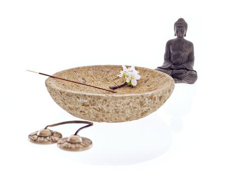 cymbal: Buddha with bowl blossom cymbal and joss stick Stock Photo