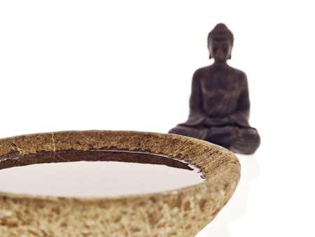 Buddha with bowl and water photo