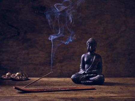 cymbal: Buddha lit on wood with joss stick and cymbal Stock Photo