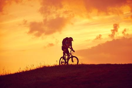 Radfahrerreiten in Sunrise