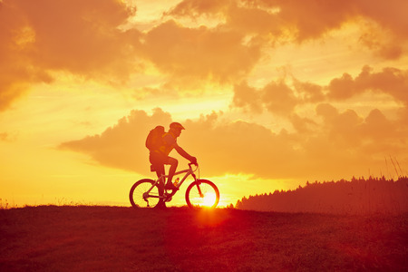 residual: Cyclist on the mountain in the sunrise