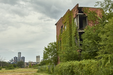 shrinking: House ruin in Detroit USA in Midtown view to GM building abandoned Editorial