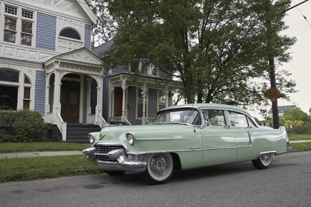 Oldtimer in front of Victorian house in Detroit United States Michigan Editorial