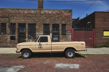 shrinking: Pickup in front of a old house with brick in Detroit United States Michigan