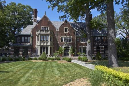 garden settlement: House with green front yard in settlement Detroit Michigan USA Editorial