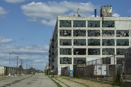 shrinking: Factory with windows and graffiti in Detroit Packard Plant USA