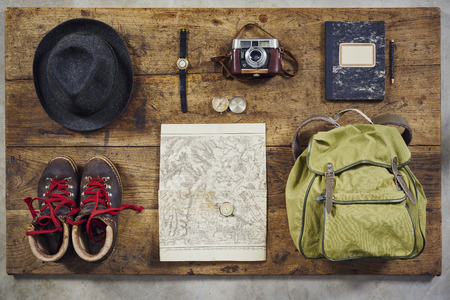 hiking boots: flatlay top hiking with hat, shirt, hiking boots and fedora Stock Photo