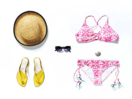 hat: flatlay from above white beach with yellow sandals sunglasses bikini and straw hat Stock Photo