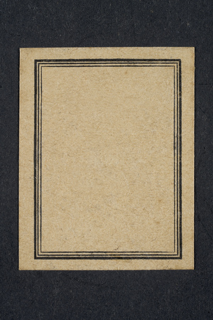 Exercise book old black and with label yellowed and frame black