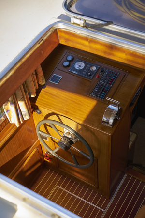 View of the steering wheel and the instruments of a wooden houseboat Banco de Imagens