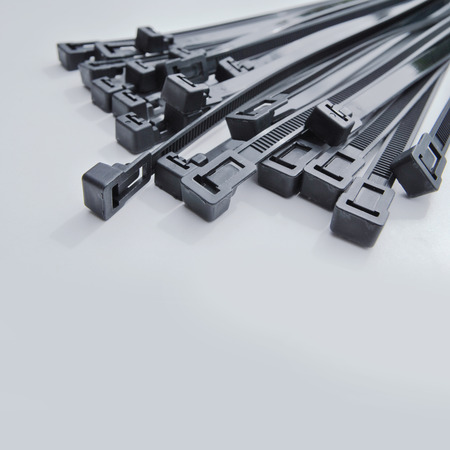 cable tie: Black cable ties Stock Photo