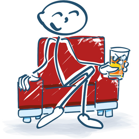 masculino: Figura del palillo con una copa en un sillón