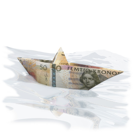 domestic policy: Little paper boat with 50 Swedish Crowns