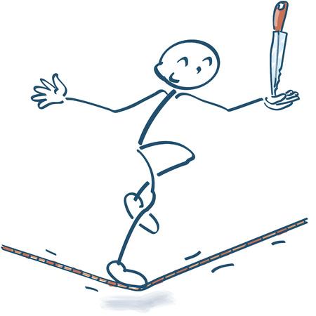 Stok figuur op het touw met een mes