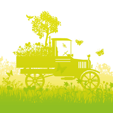 Old truck with a little tree on the loader
