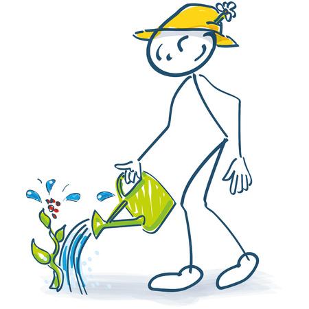 Figura de palo con una jarra de punto y coma y plantas de riego.