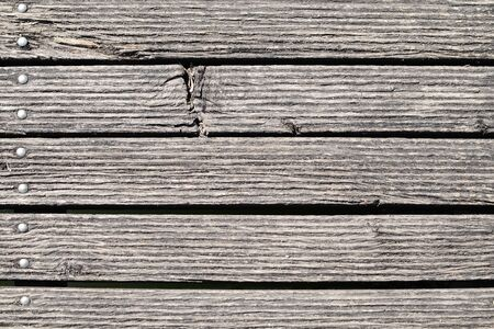 Old riveted, weathered boards and wood structure