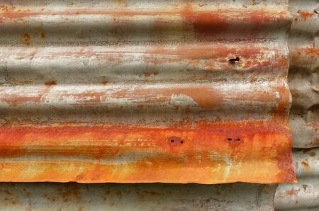 Rust on old corrugated metal sheets of a house wall Standard-Bild