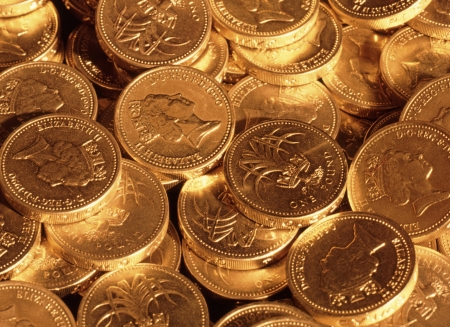 golden coins: Pound sterling coins under tungsten lighting  Stock Photo