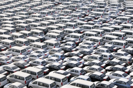 new automobiles: Bahrain dockside storage of new cars with white protective covers