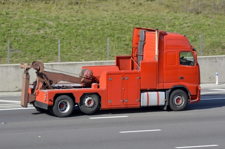 Heavy recovery breakdown tow truck on English M25 motorway UK photo