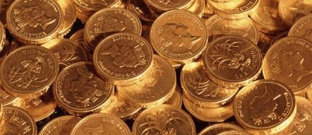 Pound coins under tungsten lighting for gold effect photo