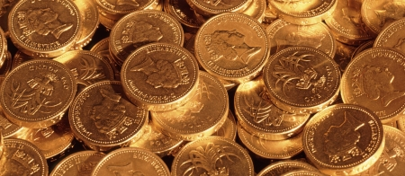 coins shot in golden color: Pound coins under tungsten lighting for gold effect