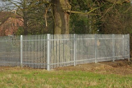 galvanize: Galvanise steel palisade fence panels around paddock England UK