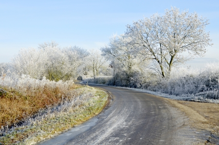 icy conditions: Icy morning on country road after severe hoar frost Stock Photo
