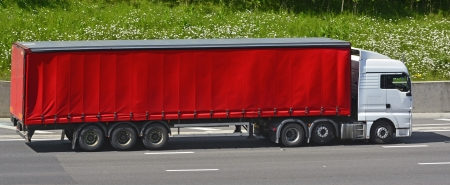 sided: Red articulated soft sided trailer and white lorry