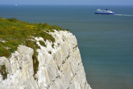 Ferry in English Channel passing the White chalk cliffs of Dover photo