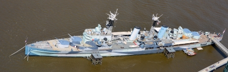 moorings: Aerial view of camouflage on warship HMS Belfast at permanent moorings on the River Thames in the Pool of London Stock Photo