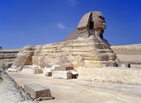 The Great Sphinx of Giza with Pyramid beyond located on the Giza Plateau on the west bank of the nile photo