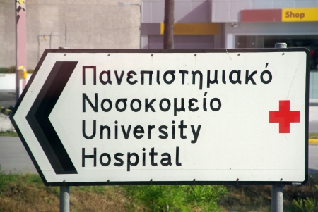directing: Mainland Greece typical road traffic sign directing towards hospital