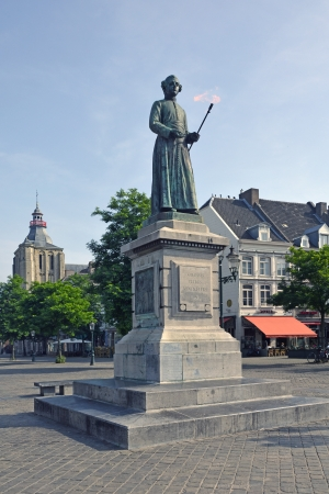 gas flame: In the market square in Maastricht the eternal burning flame on the statue of Jean Pierre Minckelers a professor and an inventor of illuminating gas  Stock Photo