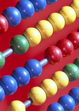 arithmetic: Close up of wooden Abacus beads on metal rods