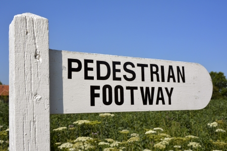 footway: Pedestrian Footway sign beside farmers field Stock Photo