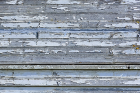 deteriorating: Neglected maintenance of timber cladding to outside of residential property
