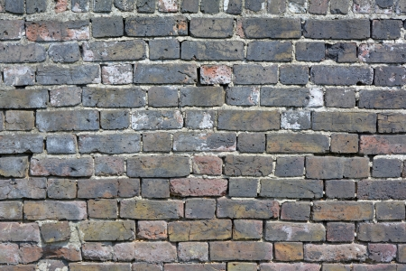 deteriorating: Old brick wall in need of repointing or rebuilding Stock Photo