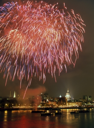 pyrotechnic displays: Fireworks over River Thames London with dome of St Pauls cathedral