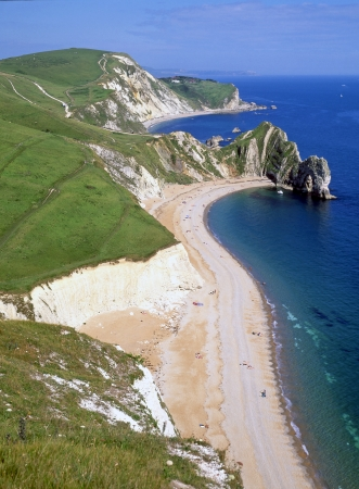 south west england: Part of the Jurassic Coast limestone cliffs and beach at Durdle Dor Dorset England  also known as Durdle Door