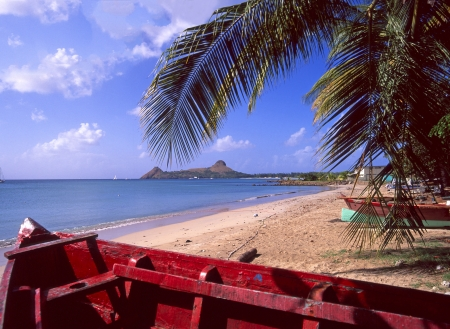 windward: St Lucia Caribbean beach with Pigeon Island beyond Stock Photo