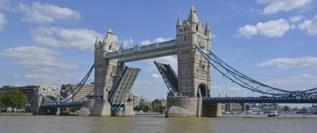 halted: River Thames with Tower Bridge raised and road traffic halted Stock Photo