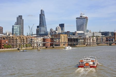 walkie talkie: City of London Skyline including new Cheesegrater and Walkie Talkie buildings and sightseeing boats